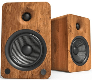 close up image of a pair Kanto YU6 Powered Bookshelf wooden Speakers in brown color