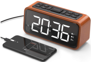 close up image of a wooden alarm clock radio with LED Digits and USB charging port by Jelly Comb-brown