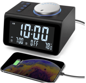 close up image of a black digital alarm clock radio with USB charging ports by JALL