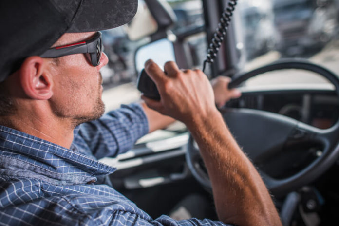 This is an image of a truck driver talking on a cb radio