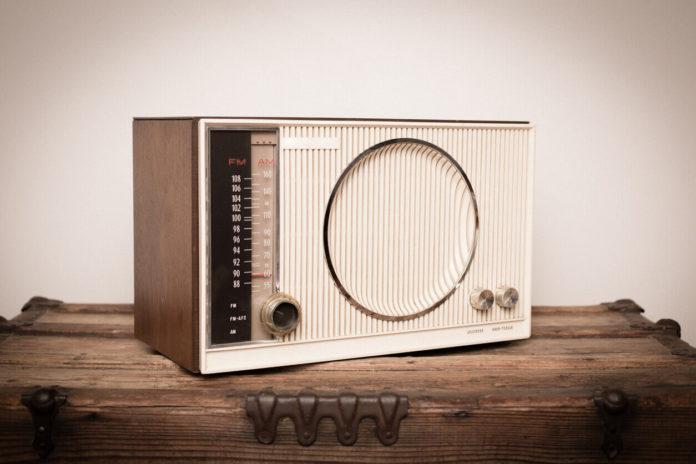 clock radio sitting on a wood table